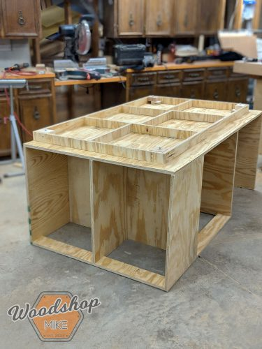 Diy outfeed workbench with torsion box wood shop mike i added a few levelers to my cabinet to help dial in the bench top with the surface of my table saw its also a good idea to keep plywood off of greentooth Choice Image
